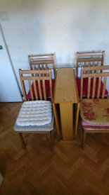 Drop-leaf pine table and 4 chairs.