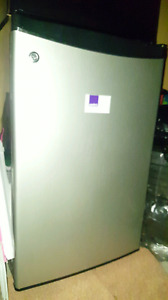 Bran new microwave and almost new Mini fridge