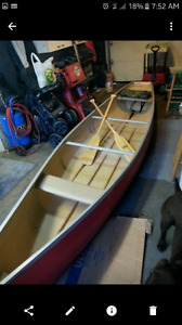 (Pending pick up)14ft flat back fiberglass canoe.
