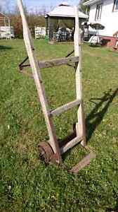 Antique barrell dolly and Antique lawn mower