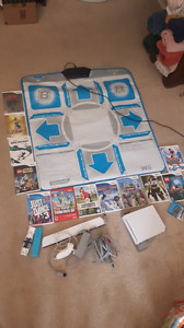 Wii console, dance pad, 12 games.