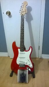 Stratocaster Squier Candy Red et Pédale Zoom 505
