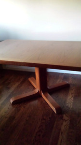 Solid Teak table. Seats 6 with extensions easily 10 people.