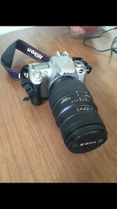 F55 Nikon camera and lens and case