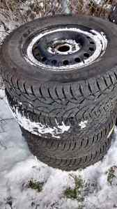 General Altimax Artic winter tires on rims
