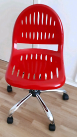 Red swivel desk chair with wheels