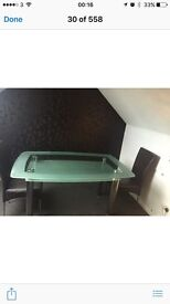 **Bargain** - reduced, must go. Glass dining table with 6 Dark brown leather dining chairs