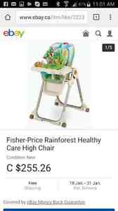 Rainforest high chair with toy