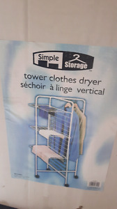CLOTHES  dryer.  TOWER CLOTHES DRYER. IN BOX