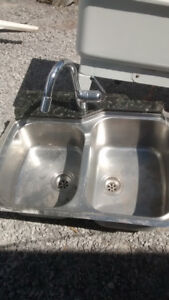 stainless still double kitchen sink with facet