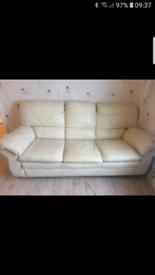 Italian cream leather 3 seater sofa and single armchair.