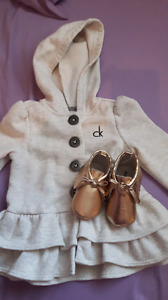 Calvin Klein spring/fall jacket with gold moccasins.