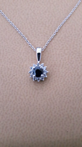 New. 14 k white gold diamond and sapphire pendant