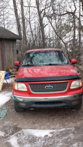 Two Ford short wheel base trucks for parts or repair.