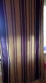 Matching pair of purple stripe curtains