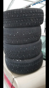 Set of Studded Uniroyal Tiger Paw 185/60R15