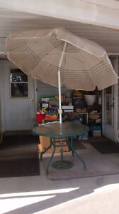 glass top table and umbrella