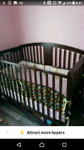 Solid wood crib with storage and bedding