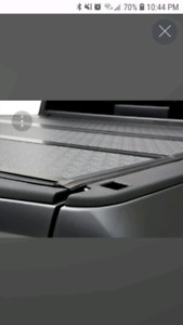 Hard tri-fold tonneau cover for F-150 five and a half foot box