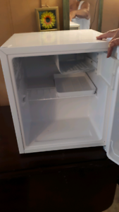 Small bar fridge only new only used for a week