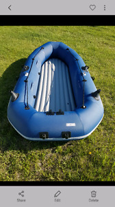 Inflatable fishing boat with canopy