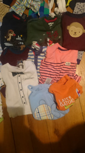 Baby boy clothes sized 6-9 months and up.