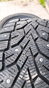 Used studded winter tires with rims