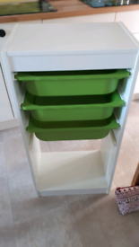 IKEA storage unit with 3 green drawers