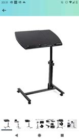 Tilting height-adjustable computer desk