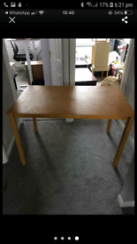 Cream leather chairs and dining table
