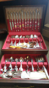 Silverware Set and Collectible Spoons.