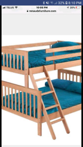 Solid wood single over double bunk beds.