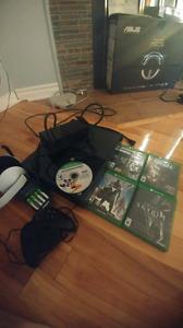 Xbox one avec une manette, casque et 5 jeux.330$