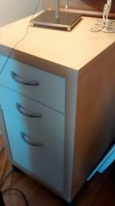 3 drawers, 1 is for files. Perfect for home office storage.