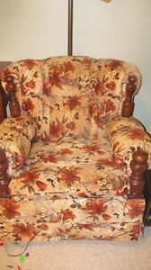 Brown flowered rocking chair with wood accents