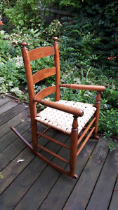 Antique wooden rocking chair canned seat