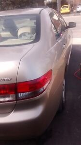 Honda Accord 2003-2.4L gold color.4 cylinders..Parting out