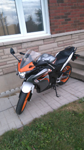 Honda 125r special adition under 15000 km on it.