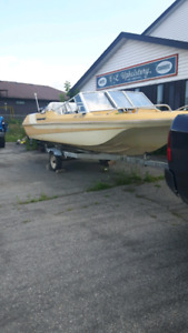 Boat, motor and trailer.