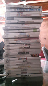 nintendo wii 3 controllers. 25 games. and others