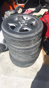 4 Honda rims (4X100) with excellent performance tires!!