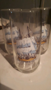 Three tall drinking glasses with the tall ships on them