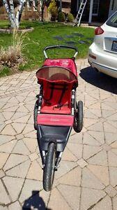 Schwinn Jogging Stroller ( not sure if it is an arrow)