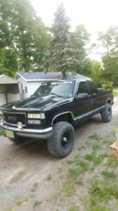 Lifted 97 gmc  - trade for race quad or race sled