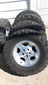 Selling five jeep rims and tires 31x10.5r15