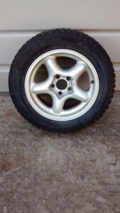 Four 215/60/R16 winter snow tires on mustang rims