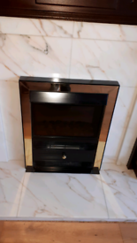 Mahogany fireplace complete with marble surround