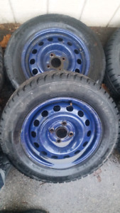 185 65 R14 snow tire and misc wheel. 4x100