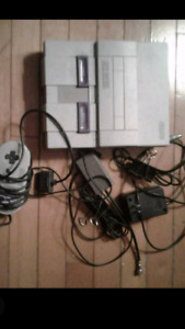 Snes console(modded) w 2 controllers and 3 games.