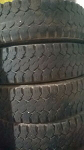 Four Toyo LT235 80 R17 open country tires.